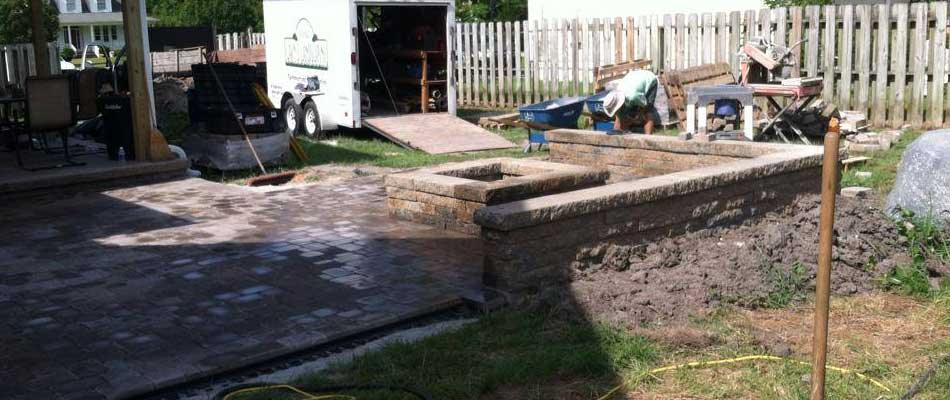 Custom fire pit and patio construction at a Swansboro, NC property.