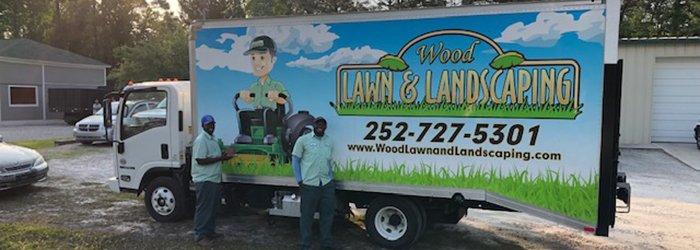 Two of our employees in front of our work truck located in Morehead City, NC.